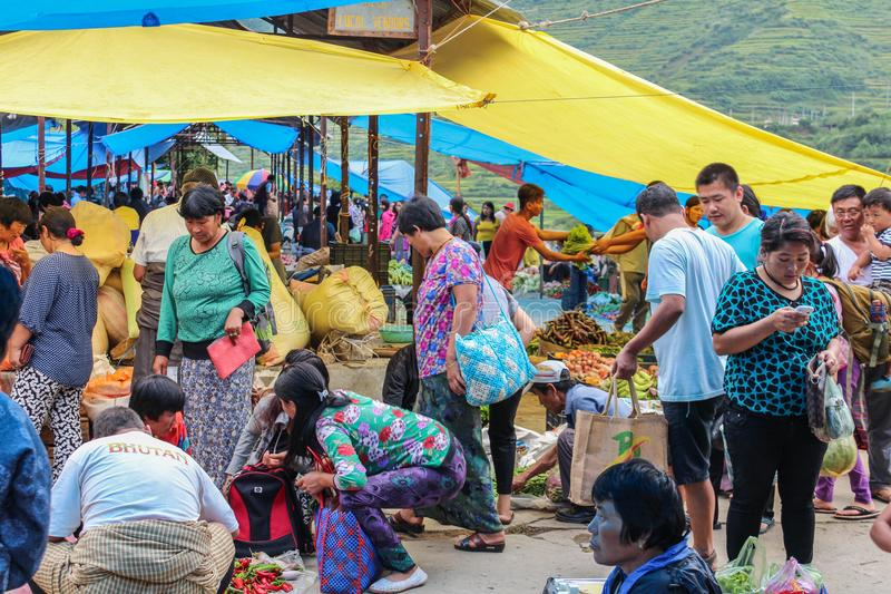 Lobesa Village, Punakha, Bhutan - September 11, 2016: Unidentified people at weekly farmers market. Fresh fruits and vegetables for sale at the local market royalty free stock image