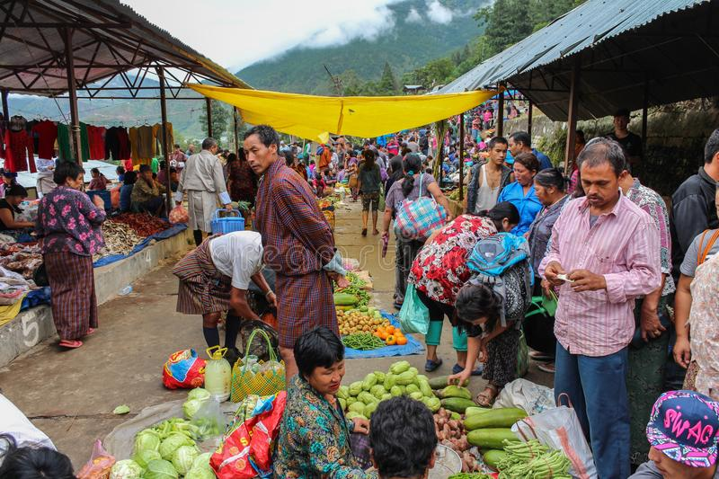 Lobesa Village, Punakha, Bhutan - September 11, 2016: Unidentified people at weekly farmers market. Fresh fruits and vegetables for sale at the local market royalty free stock photo