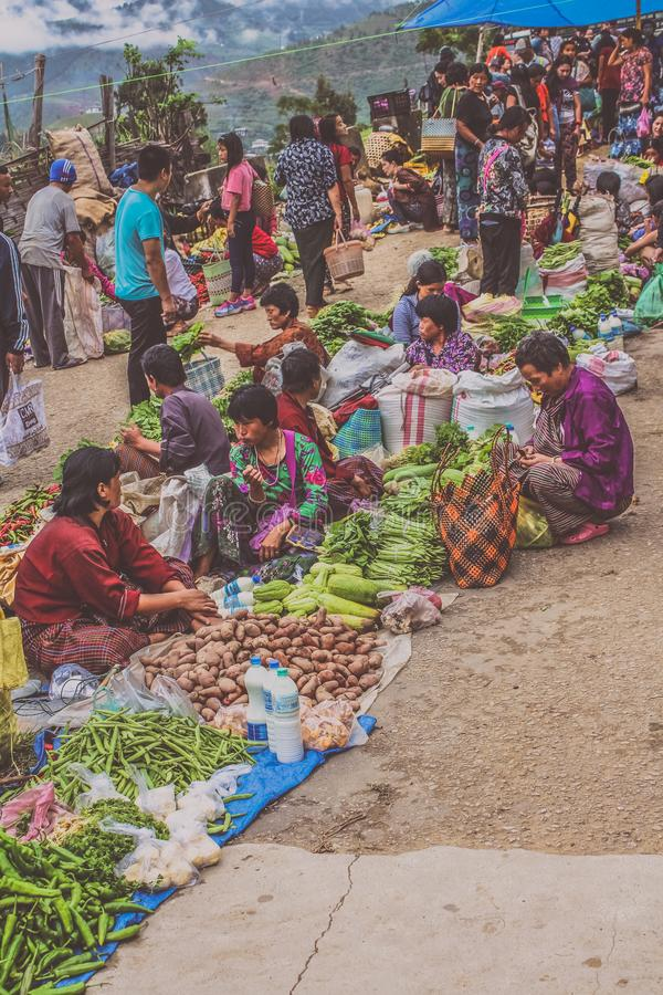 Lobesa Village, Punakha, Bhutan - September 11, 2016: Unidentified people at weekly farmers market. Fresh fruits and vegetables for sale at the local market stock photo