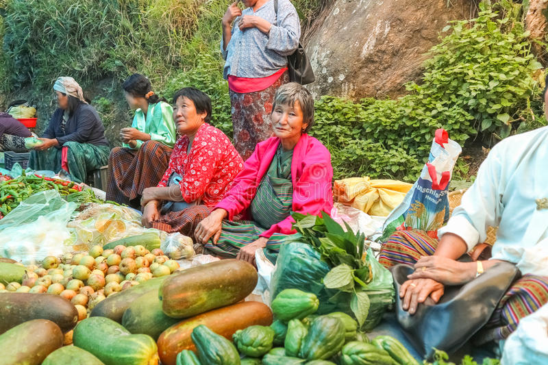 Lobesa Village, Punakha, Bhutan - September 11, 2016: Unidentified people at weekly farmers market. Fresh fruits and vegetables for sale at the local market stock images