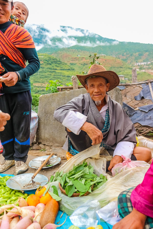 Lobesa Village, Punakha, Bhutan - September 11, 2016: Unidentified smiling old man at weekly farmers market. stock photos