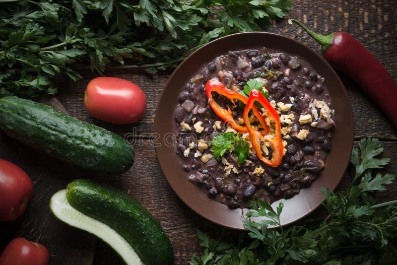 Lobio on a ceramic plate, vegetables, Georgian cuisine stock photo