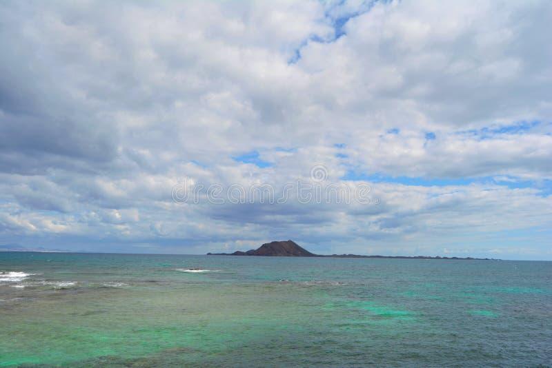 Lobos Island in emeral waters. Corralejo, Fuerteventura, Spain royalty free stock images