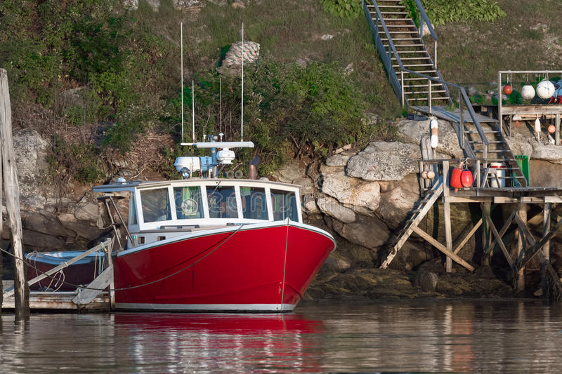 Lobster boat docked in early autumn in South Bristol, Maine, United States. Lobster boat in South Bristol, Maine, New England, US stock photo