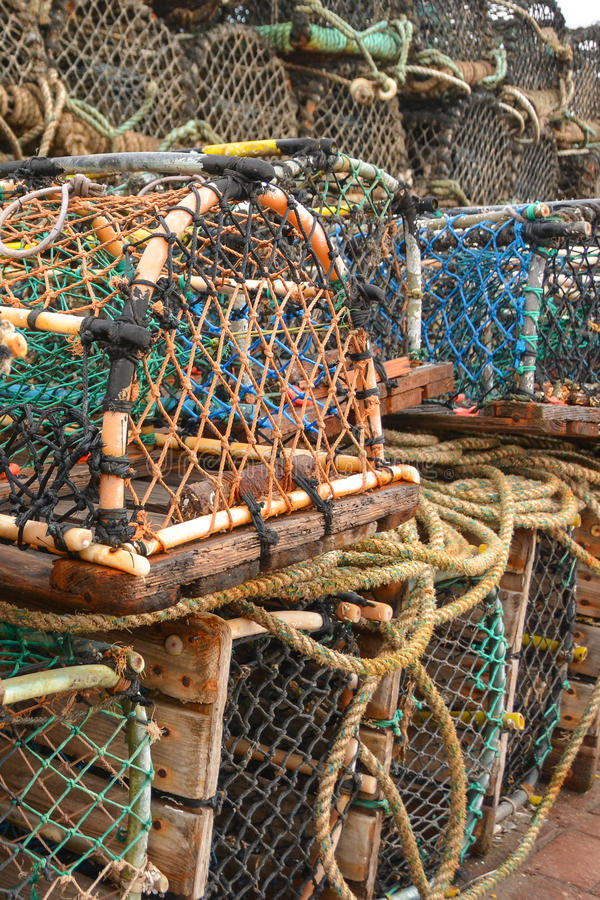 Lobster Cages on the Harbour. Lobster cages with fishing nets and ropes on the harbour stock images