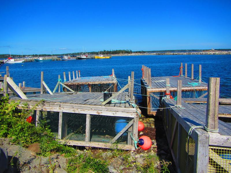 Lobster cages pulled up onshore. At a fishing village along Nova Scotia`s south shore stock photos