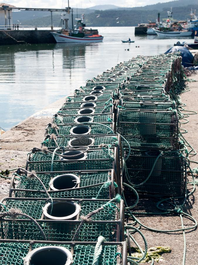 Lobster and crab fishing pot cages creels. Stacked. Fishing port stock photos