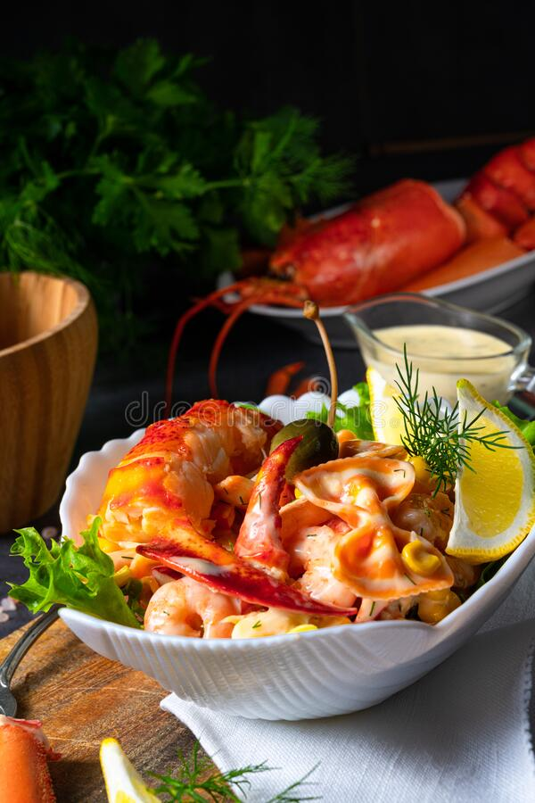 Lobster - crab salad with pasta stock photography