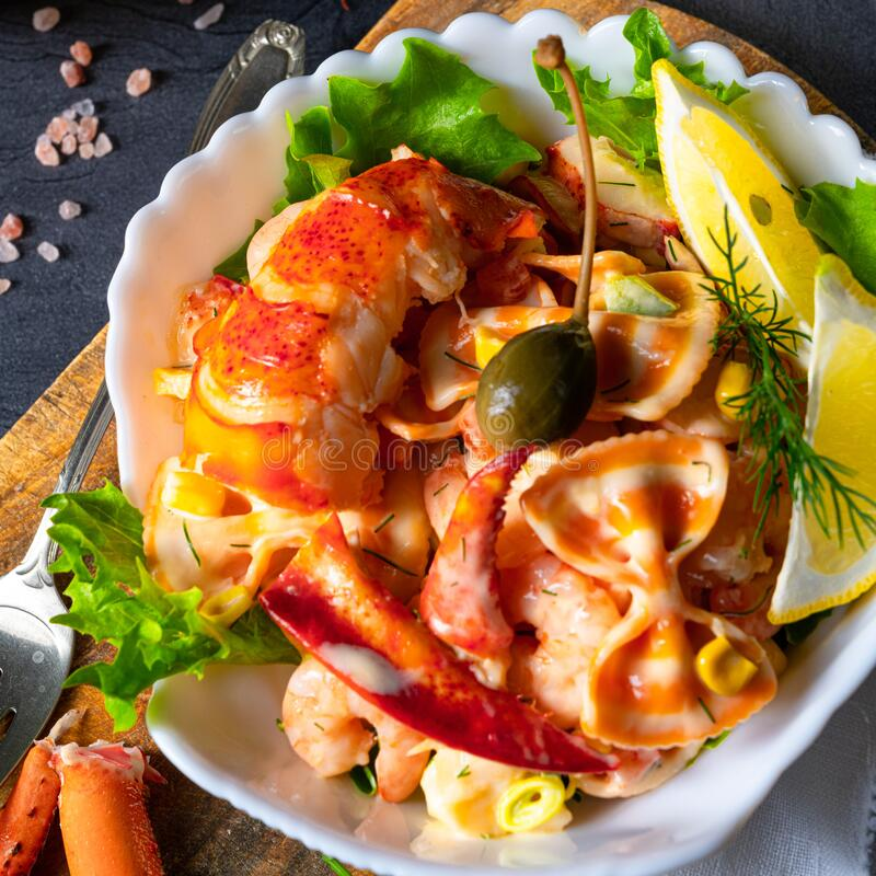 Lobster - crab salad with pasta royalty free stock image