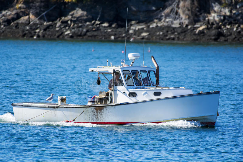 Lobster fishing boat in autumn in coastal Maine, New England stock photography