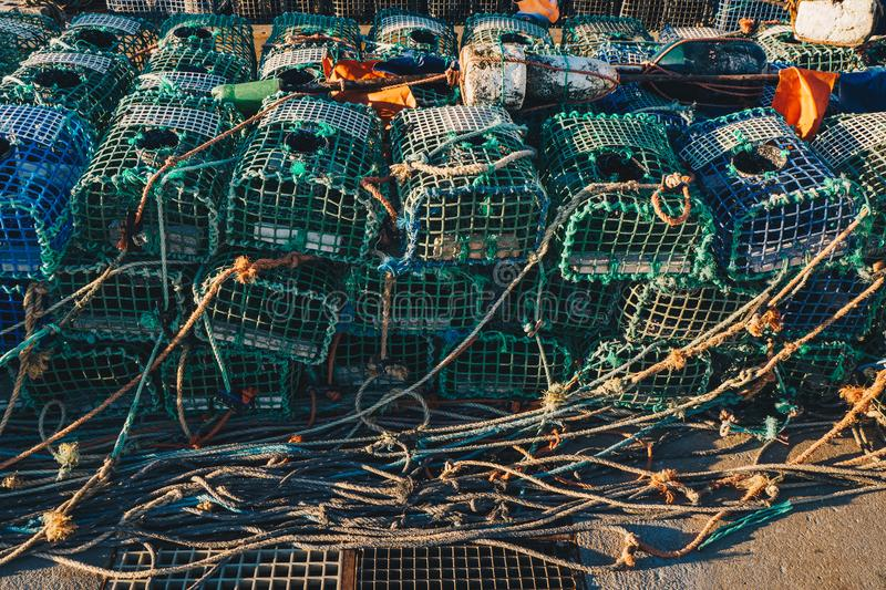 Lobster fishing cages on the shore of a fishing harbour. Lobster fishing equipment stock photos