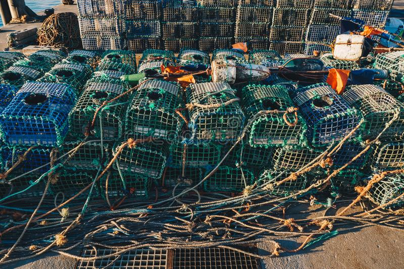 Lobster fishing cages on the shore of a fishing harbour. Lobster fishinig equipment royalty free stock photos