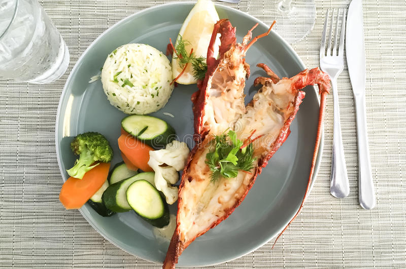 Lobster meal. Picture of lobster meal with rice and vegetables stock images