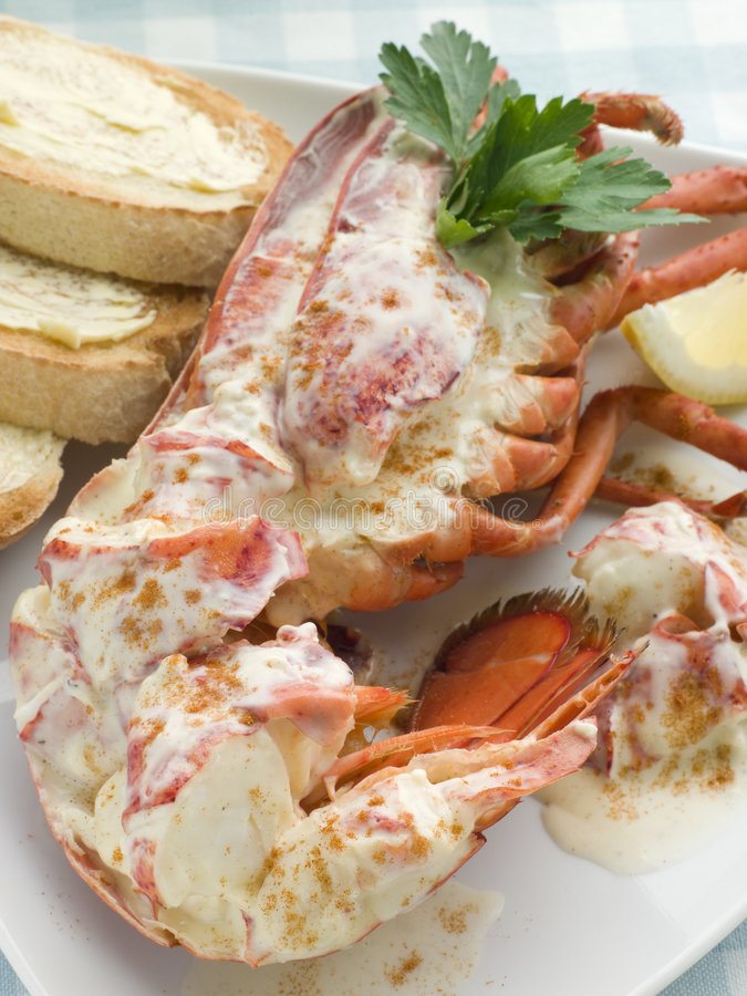 Lobster Newburg with Toast and Lemon stock photography