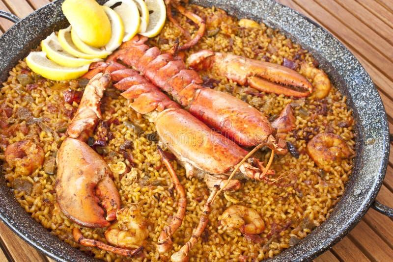 Lobster paella stock photos