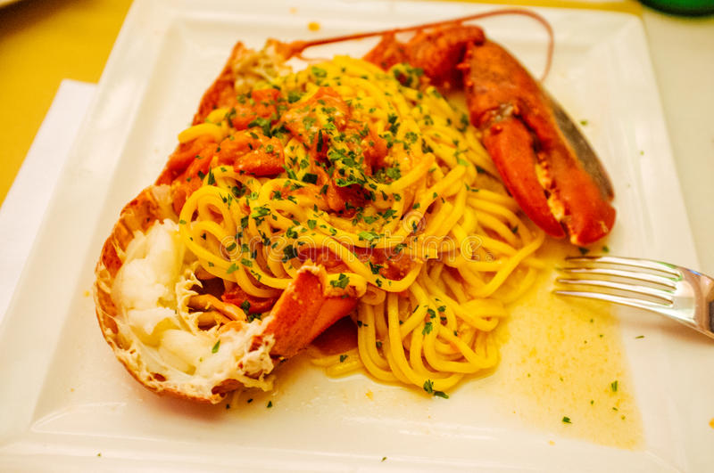 Lobster Pasta. A close up of Lobster Pasta with Fresh herbs from Restaurant La Cantinola royalty free stock image