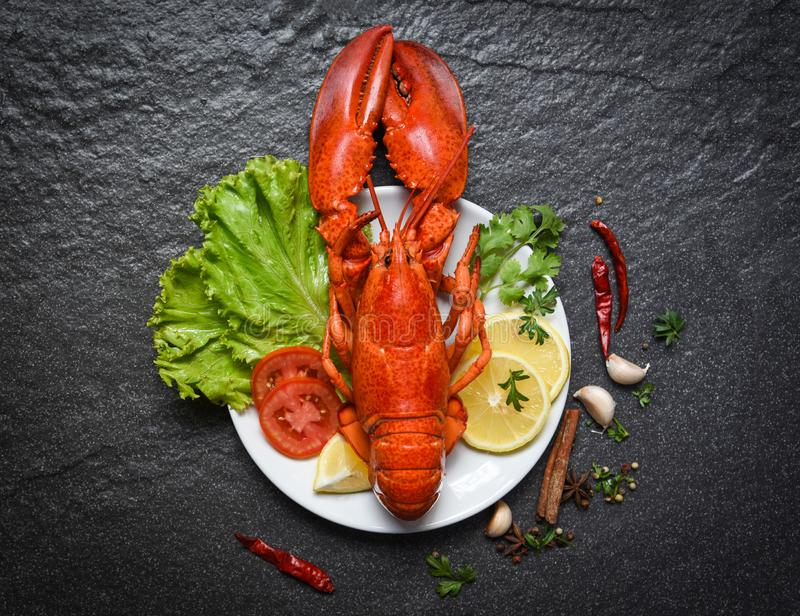 Lobster on plate seafood shellfish shrimp with lemon salad lettuce vegetable and tomato stock photography