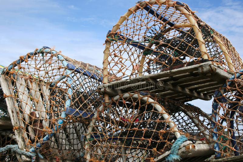 Lobster pots. Fishing. Lobster Pots, stacked ready for loading onto fishing boat stock images
