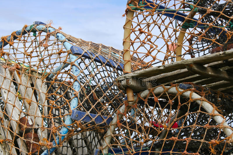 Lobster pots. Fishing. Lobster Pots, stacked ready for loading onto fishing boat stock photos