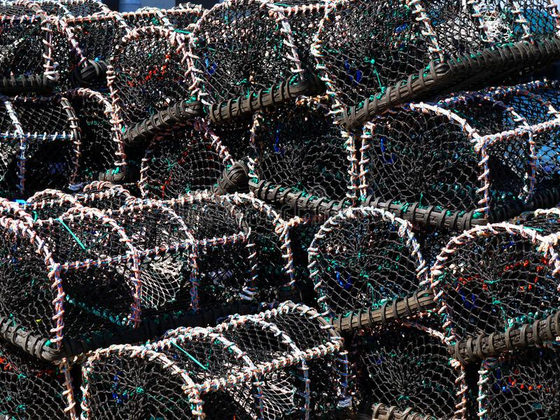Lobster Pots stacked on quayside. royalty free stock photography