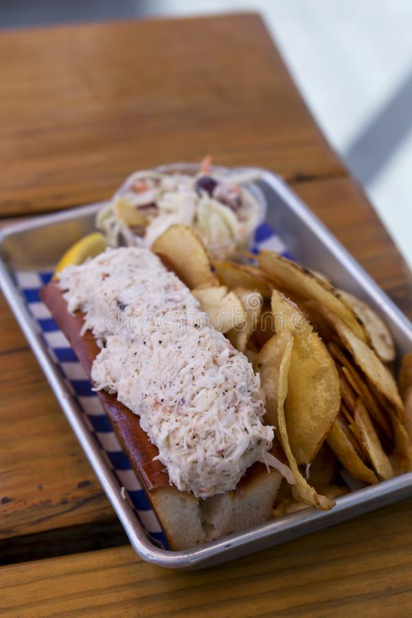 Lobster Roll with Potato Chips and Coleslaw royalty free stock images