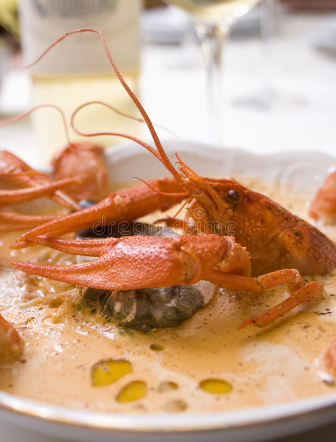 Lobster soup. In a deep white plate stock image