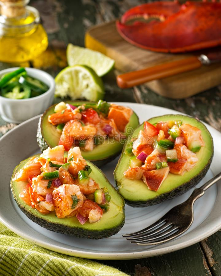 Download Lobster Stuffed Avocado stock image. Image of cilantro - 110483953