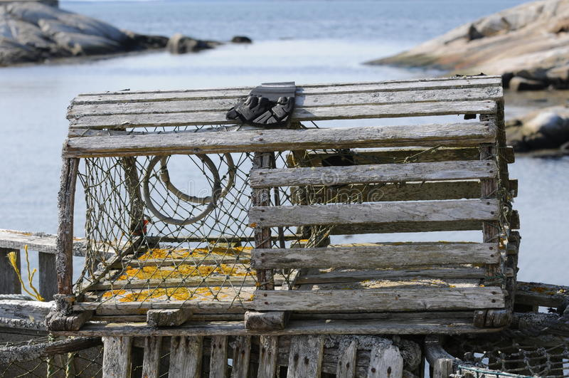 Lobster trap. Old wooden lobster trap on wharf at Peggys Cove Nova Scotia stock images