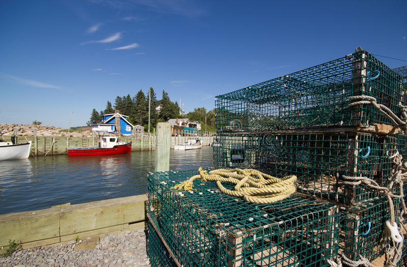 Download Lobster Traps And Fishing Boats Stock Photo - Image of crafts, coastal: 26864516