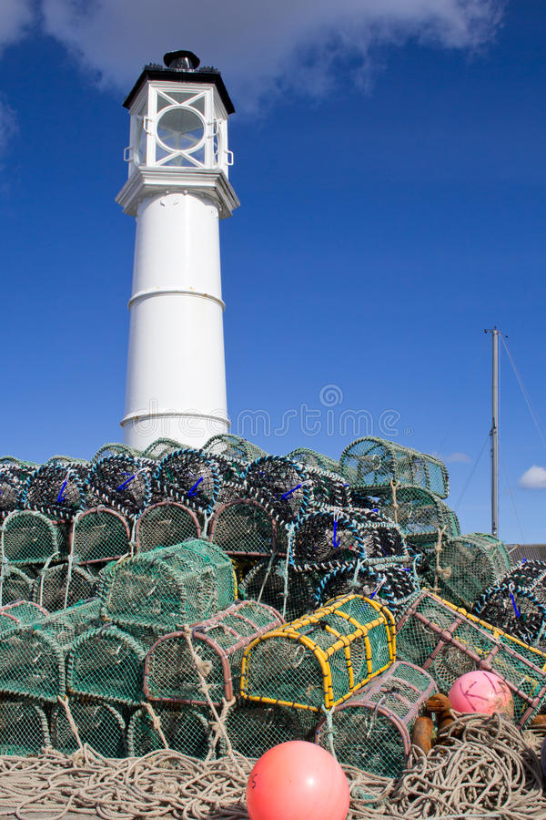 Lobster Traps With Lighthouse Stock Photo