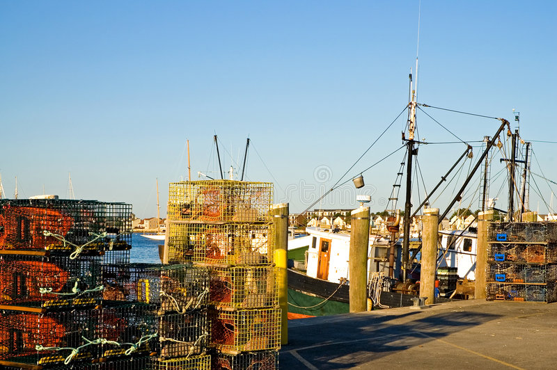 Lobster traps on pier stock images