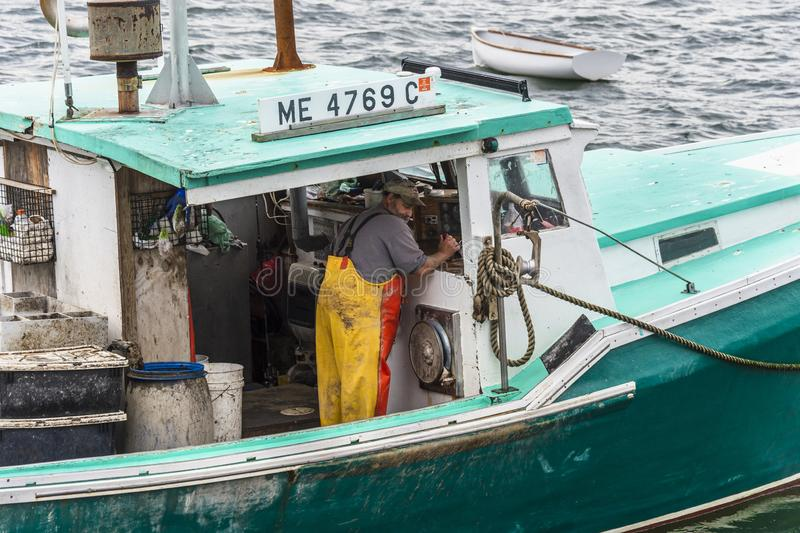Lobsterman working throttle royalty free stock image
