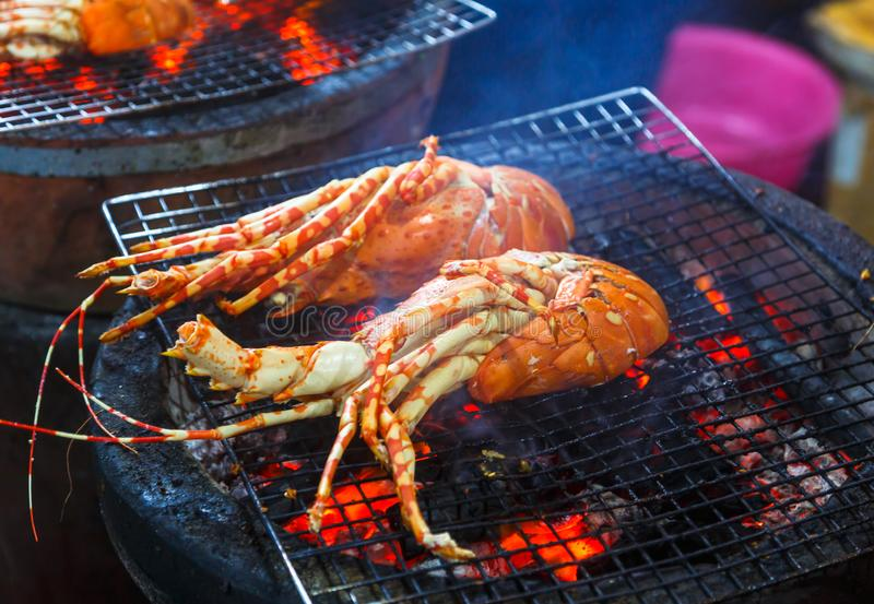 Lobsters are cooked on the grill. Dinner at an Asian restaurant royalty free stock photo