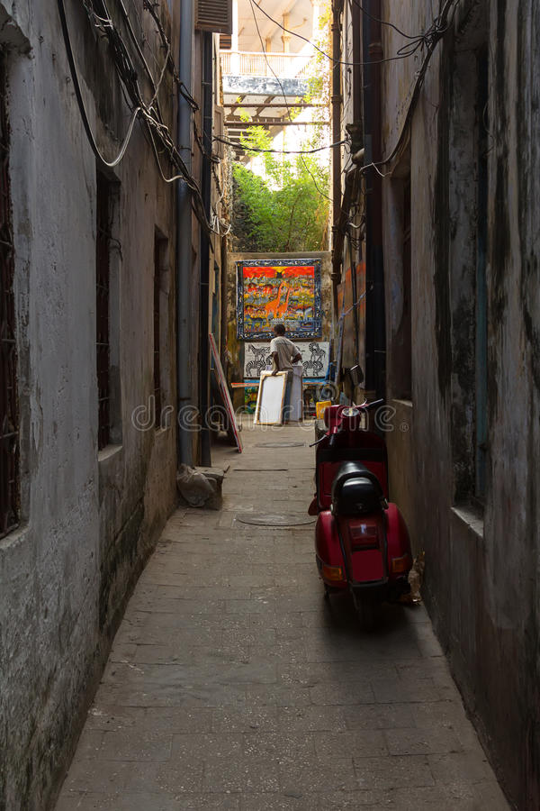 Local african artist. African art for sale at the end of a narrow alleyway stock photo