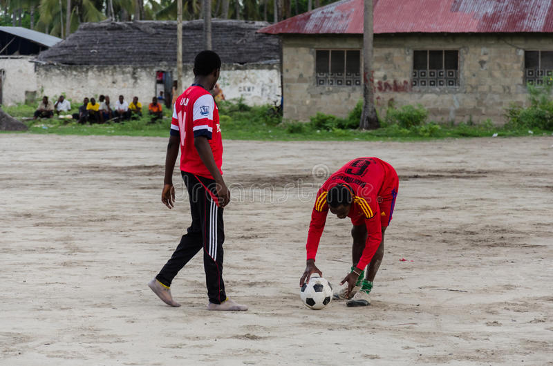 Local african soccer team during training on sand playing field. ZANZIBAR, TANZANIA - MARCH 26 2013: local african soccer team during training on sand playing royalty free stock images