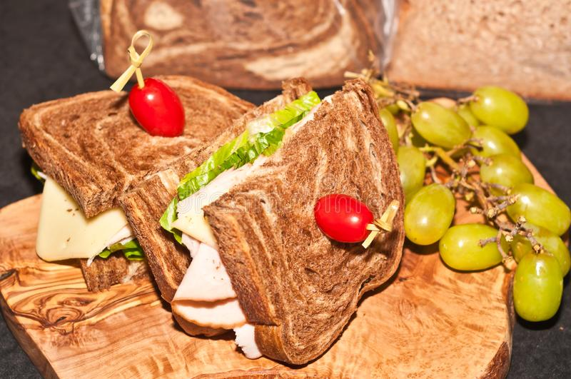 Local, artisan produced sliced smoked turkey sandwich on marble bread with lettece and a tomato at a Ft. Lauderdale, FL food show royalty free stock images