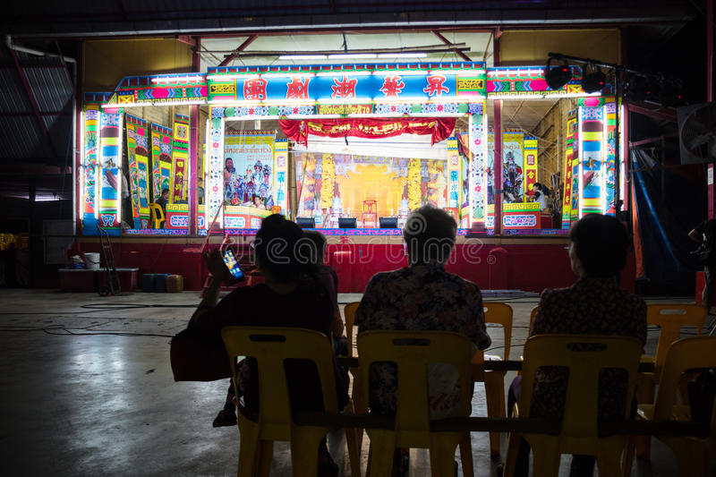 The local audience waiting for Chinese Opera performance. In Tanjung Sepat, Selangor, Malaysia on Wednesday, Jul. 19, 2017. The Opera Group is from Thailand stock photography