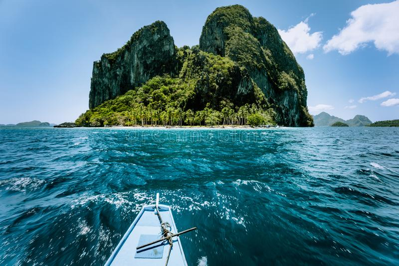 Local banca boat approaching amazing tropical island tour trip to the protected famous archipelago Bacuit El Nido stock image