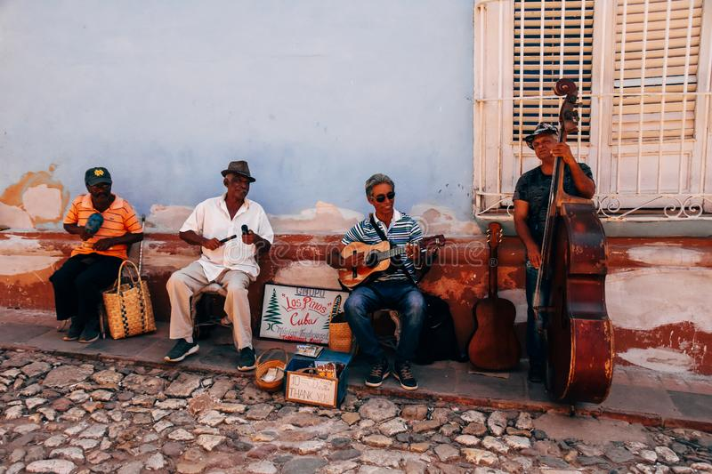 A local band plays music in the back streets of Trinidad, Cuba. royalty free stock image