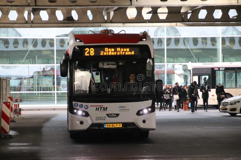 Local bus at the station of Den Haag Centraal number2002 line 28 of HTM Buzz heading Zuiderstrand stock images