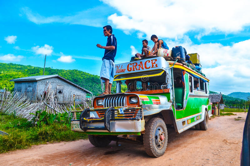 The local bus station. Loading and refueling jeepney. stock image