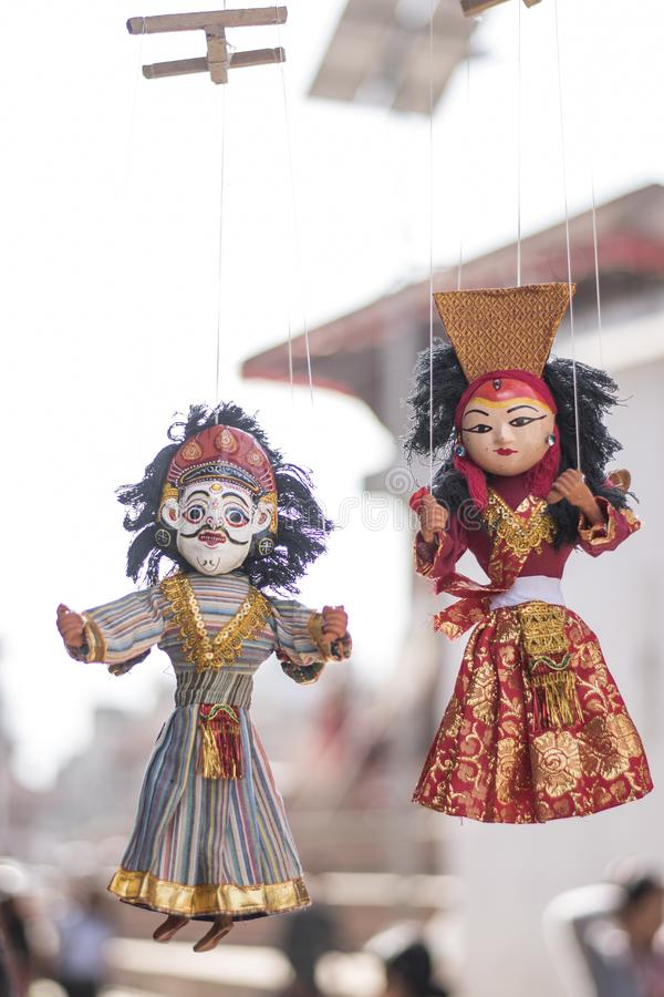Local crafts and souvenir of traditional puppets hanging for sale royalty free stock photography