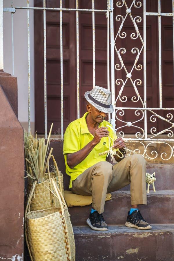 Local creating souvenirs in Trinidad, UNESCO World Heritage Site, Sancti Spiritus, Cuba, West Indies, Central America stock image