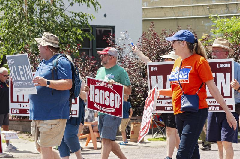 Local Democratic Party Supporters March at Parade. Mendota, Minnesota/USA - July 13, 2019: Supporters hold signs and march for Minnesota Democratic Farmer Labor stock photo