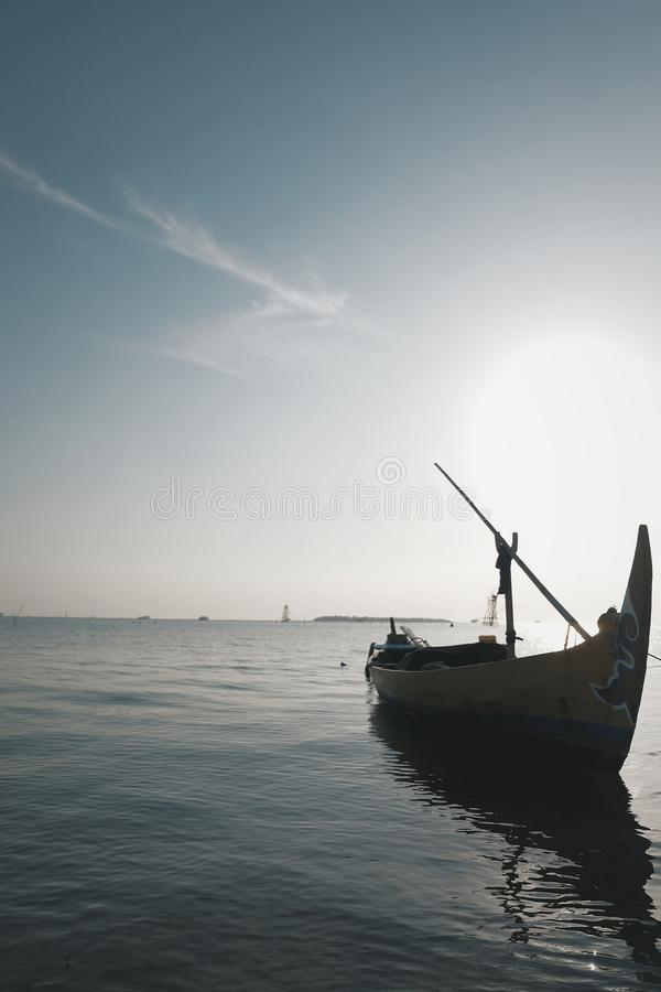 Ship and sun. Local fisheman`s traditional boat in Indonesia royalty free stock images