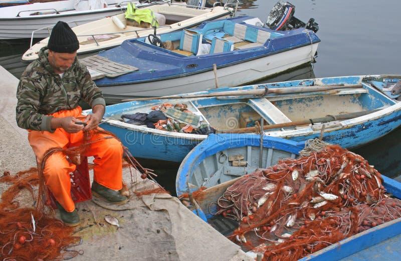 Local fisherman on Bari promenade royalty free stock photography