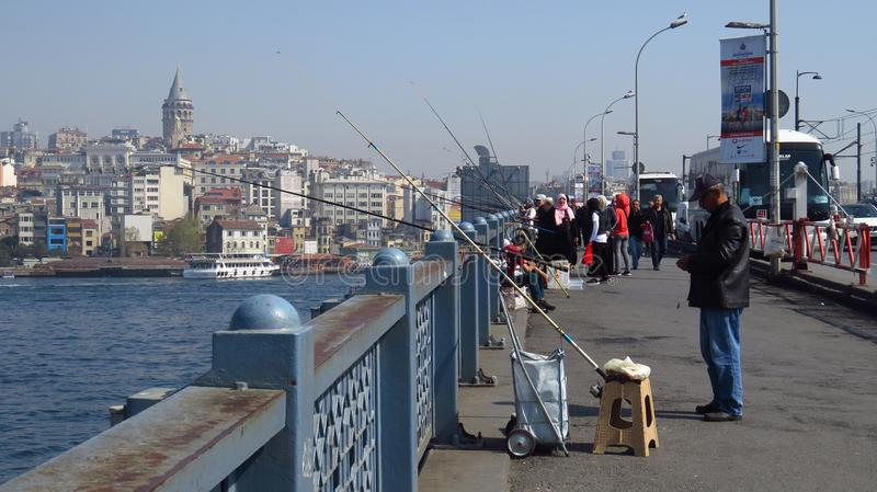 Fishermen at Galata Bridge in Istanbul stock images