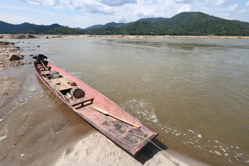 Local fishing boat by the sand on the Mekong River. In Pak Chom District, Loei Province, Thailand stock photo