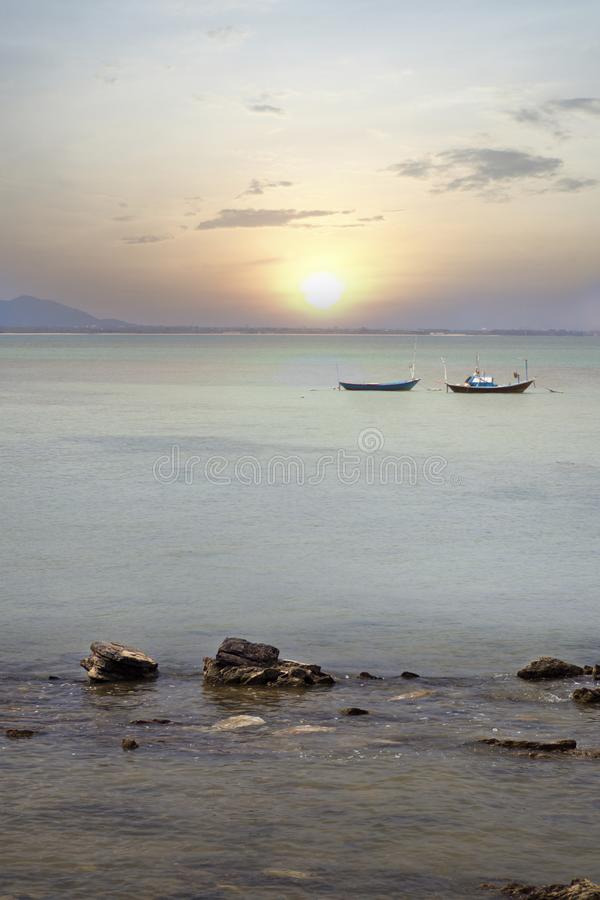 Local fishing boat in the sea landscape stock images