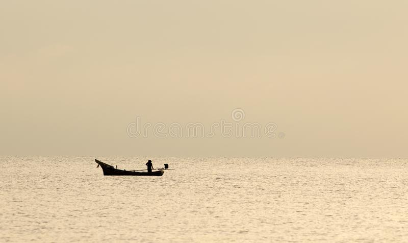 Local fishing boats fish in the sea, morning stock photos